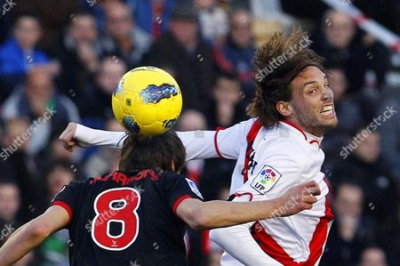 Rayo Vallecano's Miguel Perez Cuesta 'Michu' (r) Vies For the Ball with Athletic Bilbao's Ander Iturraspe (l) During Their Spanish Primera Division Soccer Match at Teresa Rivera Stadium in Madrid Central Spain 28 January 2012 Bilbao Won 3-2 Spain Madrid