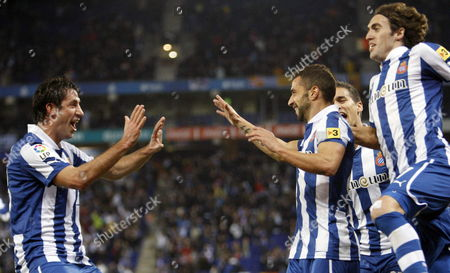 Rcd Espanyol's Portuguese Midfielder Simao Sabrosa (2r) Jubilates with His Team Mate Joan Capdevila (l) His Goal Against Mallorca During Their Primera Division Match Played at Cornella-prat Stadium in Barcelona Spain 18 January 2013 Spain Barcelona