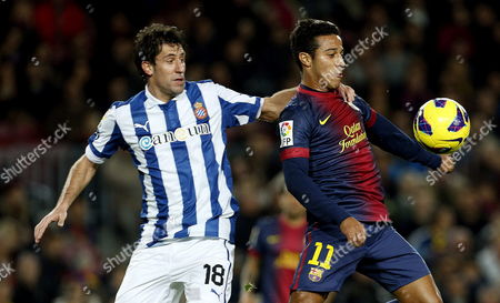 Fc Barcelona's Midfielder Thiago Alcantara (r) Duels For the Ball with Rcd Espanyol's Defender Joan Capdevila (l) During Their Spanish Primera Division Soccer Match Against Rcd Espanyol Played at Camp Nou Stadium in Barcelona Northeastern Spain 06 January 2012 Spain Barcelona
