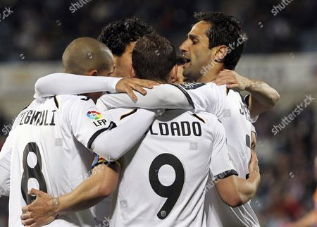 Valencia Cf's Forward Roberto Soldado (2nd R) Celebrates with His Teammates Sofiane Feghouli (l) Dani Parejo (2nd L) and Jonas Goncalves (r) After Scoring the Opening Goal Against Getafe Cf During Their Spanish Primera Division Soccer Match at Coliseum Alfonso Perez in Getafe Madrid Central Spain 24 March 2012 Spain Getafe