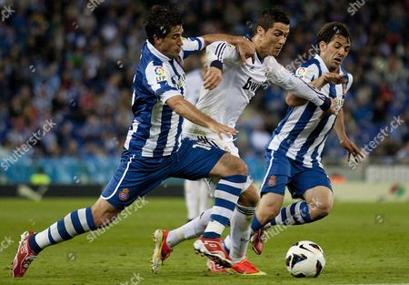 Stock Image of Real Madrid´s Portuguese Forward Cristiano Ronaldo (c) Tries to Escape Between Joan Capdevila (l) and Victor Sanchez Both of Rcd Espanyol During Their Spanish Primera Division Soccer Match Played at Cornella El Prat Stadium in Barcelona Northeastern Spain 11 May 2013 Spain Barcelona