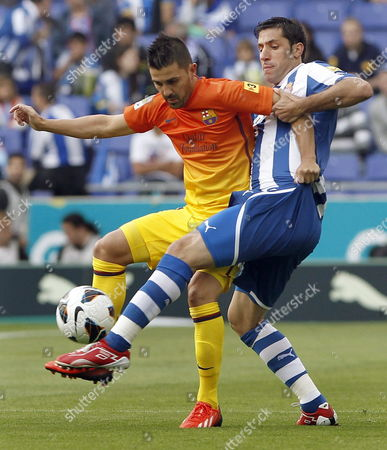 Fc Barcelona's Striker David Villa (l) Fights For the Ball with Defender Joan Capdevila (r) of Rcd Espanyol During Their Primera Division Soccer Match Played at Cornella-el Prat Stadium in Barcelona Catalonia Spain 26 May 2013 Spain Cornella