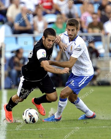 Real Zaragoza's Jose Mari (r) Vies For the Ball with Malaga's Isco (l) During Their Spanish Primera Division Soccer Match at La Romareda Stadium in Zaragoza Northern Spain 01 September 2012 Malaga Won 1-0 Spain Zaragoza