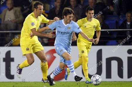 Villarreal's Midfielder Carlos Marchena (l) Vies For the Ball with Manchester City's Midfielder David Silva (c) During Their Uefa Champions League Group a Soccer Match at El Madrigal Stadium in Villarreal Eastern Spain 02 November 2011 Spain Villarreal
