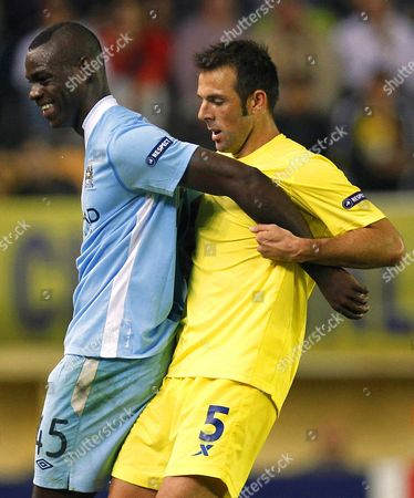 Villarreal's Carlos Marchena (r) in Action Against Manchester City's Mario Balotelli (l) During Their Uefa Champions League Group a Soccer Match at El Madrigal Stadium in Villarreal Eastern Spain 02 November 2011 Manchester City Won 3-0 Spain Villarreal