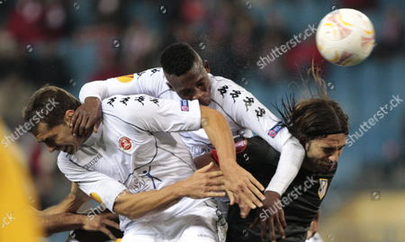 Atletico Madrid's Defender Domingo Cisma (r) Jumps For the Ball with Hapoel Tel Aviv's John Pantsil (c) and Zeev Haimovich (l) During the Uefa Europa League Soccer Match Played at Vicente Calderon Stadium in Madrid Central Spain on 22 November 2012 Spain Madrid