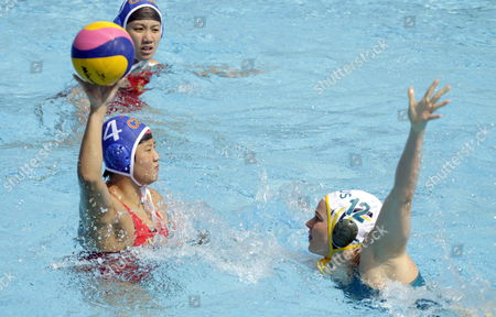 Chinese Yujun Sun (l) in Action Against Australian Nicola Zagame (r) During Their Women's Water Polo Preliminary Round Match Held at the 15th Fina World Championships in Barcelona North-eastern Spain 23 July 2013 Australia Won the Match 14-5 Spain Barcelona