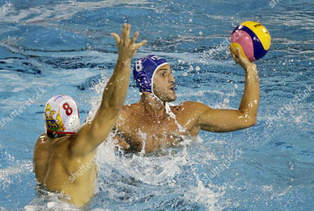 Valentino Gallo (r) of Italy in Action Against Nikola Janovic (r) of Montenegro During Their Water Polo Men's Semi-finals Match of the 15th Fina World Championships at Picornell Swimming Pool in Barcelona Spain 01 August 2013 Spain Barcelona