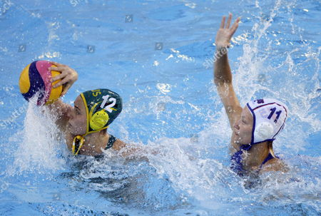 Nicola Zagame (l) of Australia in Action Against Evgeniya Ivanova (r) of Russia During Their Water Polo Women's Semi Final Match at the 15th Fina World Championships in Barcelona North-eastern Spain 31 July 2013 Spain Barcelona