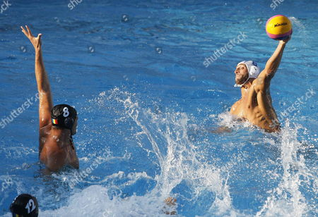 Italian Water Polo Player Valentino Gallo (r) in Action Against Romanian Mihnea Chiveanu (l) During Their Men's Water Polo Game As Part of 15th Fina World Championships at Picornell Pools in Barcelona Northeastern Spain 22 July 2013 Spain Barcelona