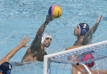 Italian Amaurys Perez (c) Throws to Score Against Kazakh Players Sergey Gubarev (r) and Roman Pilipenko (l) During Their Men's Water Polo Preliminary Group C Match Held 26 July 2013 As Part of 15th Fina World Championships at Picornell Swimming Pool in Barcelona Spain Spain Barcelona