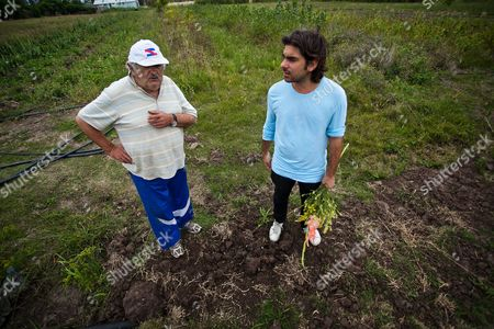 Uruguayan President Jose Mujica (l) and Artist Martin Sastre (r) Work at Mujica's Chacra (farm) Outskirts of Montevideo Uruguay 22 March 2013 an Exclusive Fragrance Made with the Scent of Flowers and Weeds Growing in the House of the Uruguayan President Known For His Austere Lifestyle Will Represent the Country at the Next Venice Biennale the Perfume of 'Pepe' is a Project of Sastre and Will Only Consist of Three Bottles One of Which Will Be Exhibited and Auctioned For Charity During the Bienniale Uruguay Montevideo