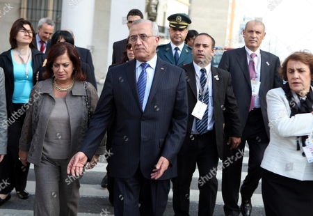 The President of Lebanon Michel Sleiman (c) Walks to a Sculpture of Uruguayan Hero Jose Artigas where He Will Lay a Wreath After a Meeting with His Uruguayan Counterpart Jose Mujica in Montevideo Uruguay 05 October 2012 Uruguay Montevideo