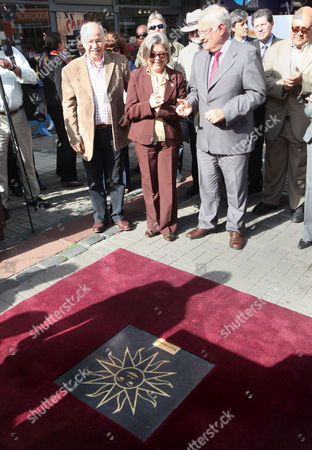 The President of the Commission of Culture From the Committee of Montevideo Dari Mendiondo (l) the President of the Committee of Montevideo Gloria Benítez (c) and the Ambassador of South Africa in Uruguay David Jacobs (r) Participate During the Inauguration of the Plaque Which Contains the 'Sun For Mandela' a Golden-colored Figure Similar to the Sun of the Uruguayan Flag in the Pedestrian Walkway Sarandí of Downtown Montevideo Uruguay 26 October 2012 the Plaque is a Tribute in Honor of South African Former President (1994-1999) and Nobel Peace Prize 1993 Nelson Mandela Uruguay Montevideo