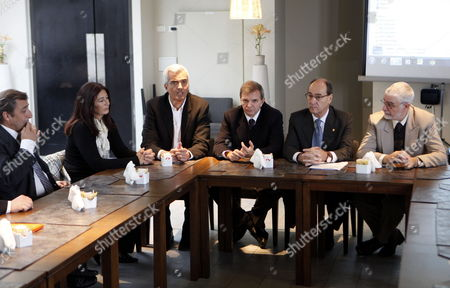 (l-r) Uruguayan Soccer Asociation (auf) Leader Arturo Del Campo; General Director of the Tourism and Sport Minister Hyara Rodriguez; Argentinean Entrepenour Alberto García Carmona; Auf President Sebastián Bauzá; National Sports Director Irurueta Diaz and National Director of Tourism of Uruguay Benjamin Liberoff Meet with Uruguayan Businessman to Support the Iniciative to Lauch the Candidacy of Been Cohost Along with Argentina of the 2030 World Cup in Montevideo Uruguay on 21 May 2013 the Uruguayan Government Defended the Nomination by Appealing to the Passions Aroused by Soccer in the Two Nations and the Coincidence with the Anniversary of the First World Cup Held in Uruguay in 1930 Uruguay Montevideo