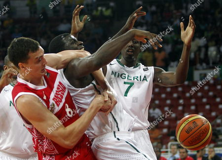 Russian Basketball Player Sergei Karasev (l) Fights For the Ball Against Al-farouq Aminu (r) of Nigeria During the Preolympic Basketball Game Tournament Held in Caracas Venezuela on 7 July 2012 Venezuela Caracas