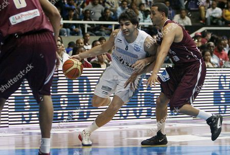 Argentina's Player Luciano Gonzalez (c) Vies For the Ball Against Michael Flores (r) of Venezuela During a Basketball Match of the Super 4 Caracas Tournament in Preparation For the South American Championship and the London 2012 Olympics in Caracas Venezuela 04 June 2012 Venezuela Caracas