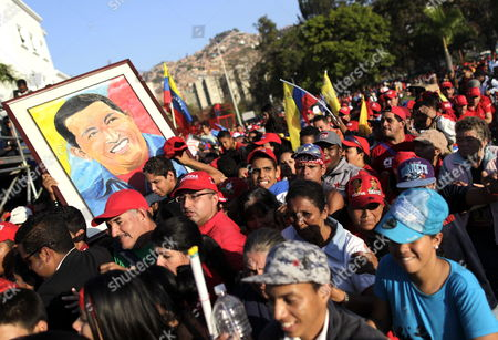 Supporters of Late Venezuelan President Hugo Chavez Queue to Enter His Funeral Chapel at the Military Academy in Caracas Venezuela 08 March 2013 Chavez Died 05 March After a Long Battle with Cancer More Than 2 Million People Were Hoping to See Him at His State Funeral Communications Minister Ernesto Villegas Said Venezuela Caracas