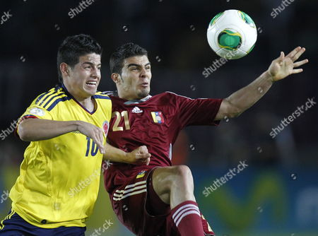 Venezuela´s Alexander Gonzalez (r) Fights For the Ball with Colombia´s James Rodriguez During Their Match of the South American Qualifying Round For Brazil 2014 in Puerto Ordaz Venezuela 26 March 2013 Venezuela Puerto Ordaz