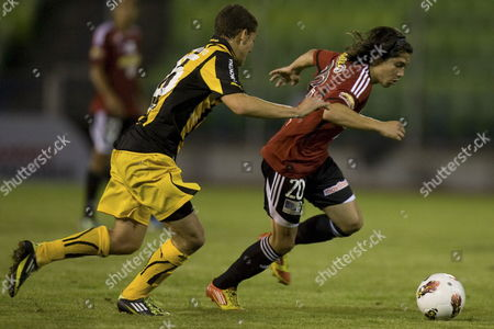 Penarol Player Sebastian Cristofono (l) Vies For the Ball with Jesus Meza (r) During the Libertadores Cup Game in Caracas Venezuela on 02 February 2012 Penarol Qualified to the Groups Phase of the Tournament After Tying 1-1 Venezuela Caracas