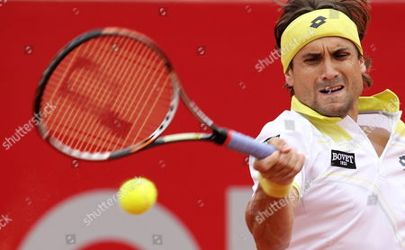 Stock Photo of Spaniard David Ferrer Returns to Argentinian Agustin Velotti During Their First Round Match of the Copa Claro Tennis Tournament in Buenos Aires Argentina 20 February 2013 Argentina Buenos Aires