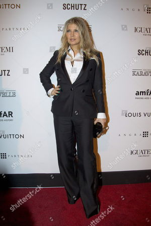 Us Band Black Eyed Peas Siger Stacy Ann Ferguson Aka Fergie Poses at Her Arrival to the Annual Amfar Gala Inspiration That Supports the Fight Against Hiv /aids in Sao Paulo Brazil 05 April 2013 Brazil Sao Paulo