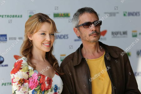 Australian Singer and Actrees Kylie Minogue (l) and French Director Leos Carax Pose During a Press Conference of Their Movie 'Holy Motors' During the Rio De Janeiro's Film Festival in Rio De Janeiro Brazil 02 October 2012 Brazil Rio De Janeiro