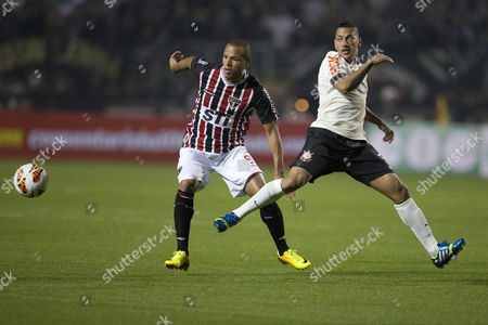 Luis Fabiano (l) From Sao Paulo Vies For the Ball with Ralf (r) From Corinthians During Their Match of the Recopa Sudamericana Held at the Stadium Pacaembu in the City of Sao Paulo Brazil 17 July 2013 Brazil Sao Paulo