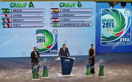 Fifa Secretary General Jerome Valcke (c) Brazilian Model Adriana Lima (r) and Brazilian Chef Alex Atala During the Draw Ceremony For the Fifa Confederations Cup Brazil 2013 at the Anhembi Convention Centre in Sao Paulo Brazil 01 December 2012 the Draw Ceremony Revealed That Host Brazil Will Face Japan Mexico and Italy (group A) in the Group Phase While Spain Will Clash Uruguay Tahiti and the Next African Champion (group B) the Ninth Fifa Confederations Cup Will Take Place in Brazil From 15 to 30 June 2012 Brazil Sao Paulo