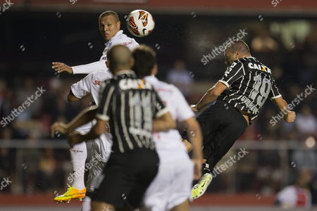 Brazilian Sao Paulo Soccer Team Player Luis Fabiano (l) Fights For the Ball with Corinthians' Guilherme (r) During Their Recopa Sudamericana Match at the Morumbi Stadium in Sao Paulo Brazil 03 July 2013 Brazil Sao Paulo