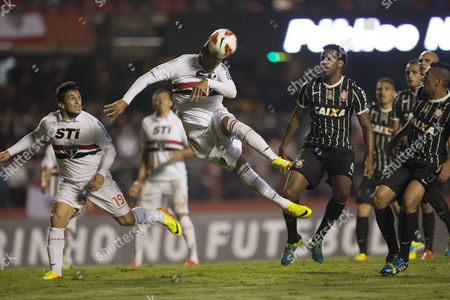 Brazilian Sao Paulo Soccer Team Player Luis Fabiano (c) Goes For a Header in Front of Corinthians Players (r) During Their Recopa Sudamericana Match at the Morumbi Stadium in Sao Paulo Brazil 03 July 2013 Brazil Sao Paulo