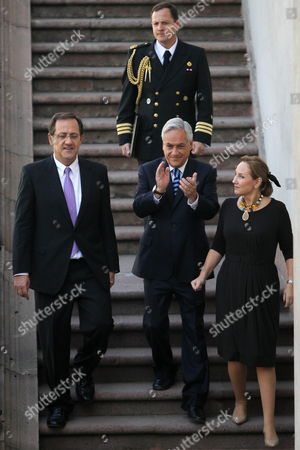 Chilean President Sebastian Pinera (c) and His Wife Cecilia Morel (r) Participate in a Farewell Ceremony For Dismissed Chilean Education Minister Harald Beyer (l) at the Palacio De La Moneda in Santiago Chile 18 April 2013 Media Reports State That Beyer is to Be Banned From Holding Public Office For Five Years Following the 20-18 Vote by the Chilean Senate on 17 April 2013 the Ban is For Alleged Professional Misconduct and For Allegedly Failing to Monitor Profits in the Chilean Education Sector Chile Santiago