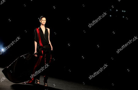A Model Takes the Catwalk Wearing a Creation of Colombian French Designer Haider Ackerman During the Inaugural Fashion Show of Colombiamoda 2013 Held in the City of Medellin Colombia 22 July 2013 Colombia Medellin