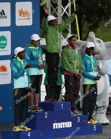 Athletes Priscah Jeptoo From Kenya (1) Ines Melchor From Peru (2) Amane Gobena From Ethiopia (3) Flomena Chepchichir From Kenya (4) and Isabella Ochichi From Kenya (5) Pose on the Podium For the Media Maraton De Bogota Competition in Bogota Colombia 28 July 2013 Kenyan Athlete Geoffrey Kipsang in the Men's Competition and Priscah Jeptoo in the Women's Competition Won with 1h03 46 and 1h12 24 in Times Respectively Around 45 000 Athletes Participate in a Competition Colombia Bogota