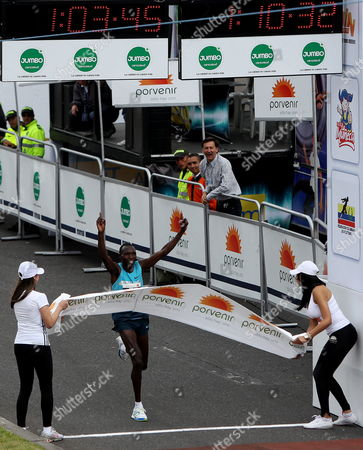 Kenyan Athlete Geoffrey Kipsang Cross the Final Line at Media Maraton De Bogota Competition in Bogota Colombia 28 July 2013 Kenyan Athlete Geoffrey Kipsang in the Men's Competition and Priscah Jeptoo in the Women's Competition Won with 1h03 46 and 1h12 24 in Times Respectively Around 45 000 Athletes Participate in a Competition Colombia Bogota