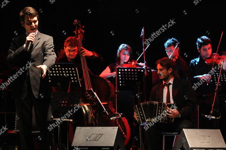 Argentine Singer Juan Sebastian Gutierrez (l) and the Medellin Tango School Orchestra Perform During the Opening of 6th Medellin Tango International Festival 2012 in Medellin Colombia 22 June 2012 Colombia Medellin