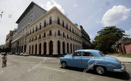 Stock Image of A Car Passes by Sloppy Joe's One of Havana's Most Famous Pre-revolutionary Bars Known For Its Long Bar and Famous Customers Such As Us Author Ernest Hemingway and Us Actor Spencer Tracy in Havana Cuba 12 April 2013 Sloppy Joe's Reopened After Nearly Half a Century in Ruins After Lengthy Reconstructions Cuba Havana