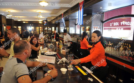Customers Gather at Sloppy Joe's One of Havana's Most Famous Pre-revolutionary Bars Known For Its Long Bar and Famous Customers Such As Us Author Ernest Hemingway and Us Actor Spencer Tracy in Havana Cuba 12 April 2013 Sloppy Joe's Reopened After Nearly Half a Century in Ruins After Lengthy Reconstructions Cuba Havana
