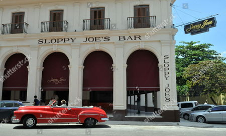A Car Passes by Sloppy Joe's One of Havana's Most Famous Pre-revolutionary Bars Known For Its Long Bar and Famous Customers Such As Us Author Ernest Hemingway and Us Actor Spencer Tracy in Havana Cuba 12 April 2013 Sloppy Joe's Reopened After Nearly Half a Century in Ruins After Lengthy Reconstructions Cuba Havana