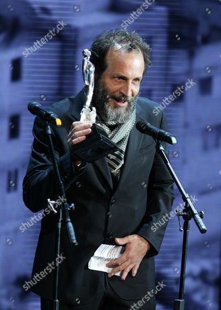Spanish Actor Daniel Gimenez Cacho Receives the Ariel Award to Best Spanish American Film For 'Blancanieves' in Representation of Spanish Director Pablo Berger During the 55th Edition of Ariel Awards Ceremony by Mexican Academy of Arts and Cinematographic Sciences at Bellas Artes Palace in Mexico City Mexico 28 May 2013 Mexico Mexico City