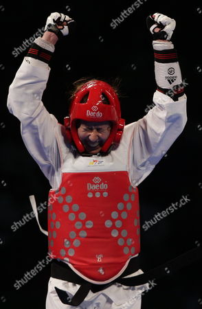 Russia's Olga Ivanova Celebrates After Defeating France's Anne Caroline Graffe in the Category of +53 Kg During the Fourth Day of the World Championship of Taekwondo in Puebla Mexico 18 July 2013 Mexico Puebla