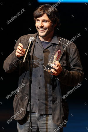 Spanish Director Diego Quemada-diez Receives the Spondylus Award For Best First Work For the Hispanic-mexican Film 'La Jaula De Oro' at the Closing Ceremony of the 17th Lima Film Festival at the Great National Theatre in Lima Peru 17 August 2013 Peru Lima