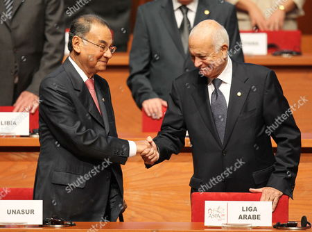 General Secretary of Unasur Venezuelan Ali Rodriguez (l) Greets His Counterpart of Arab League Nabil Al Araby (r) During the 3rd Summit of South America-arab Countries at National Theatre of Lima Peru 02 October 2012 the Summit Began with the Call to Reinforce the Relations Between the Two Regions and Declarations Over the Situation of Countries As Syria and Palestine Peru Lima