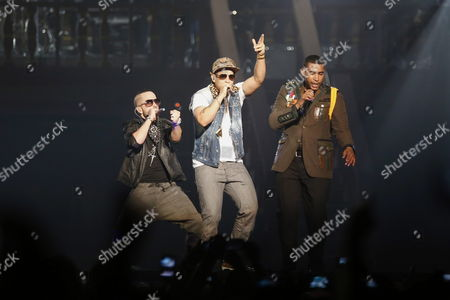 Puerto Rican Singers Don Omar (r) Performs with Daddy Yankee (c) and Yandel (l) on Stage During the Concert 'Made in Puerto Rico' After Five Years of Absence on the Island in San Juan Puerto Rico 03 May 2013 Puerto Rico San Juan