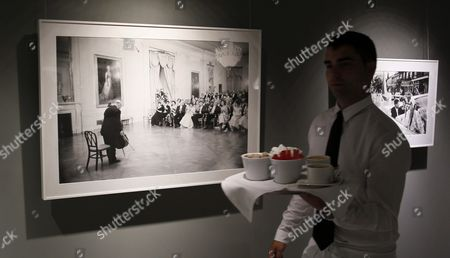 A Waiter Walks by One of the 40 Photographs Displayed at 'The Kennedys' Exhibition Held on the Occasion of Photoespana 2013 in Madrid Spain 06 June 2013 the Exhibition Features Pictures Taken by Us Photographer Mark Shaw (1921-1969) From the Time of the Election of John F Kennedy As Us President in 1960 Until His Murder in 1963 the International Festival of Photography and Visual Arts Photoespana Runs Until 28 July Spain Madrid