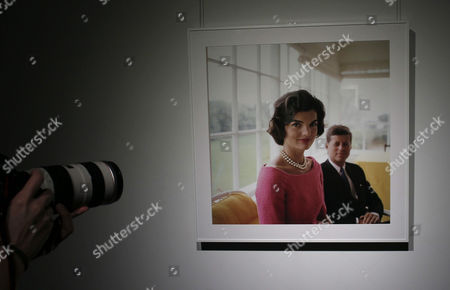 A Person Takes Pictures of One of the 40 Photographs Displayed at 'The Kennedys' Exhibition Held on the Occasion of Photoespana 2013 in Madrid Spain 06 June 2013 the Exhibition Features Pictures Taken by Us Photographer Mark Shaw (1921-1969) From the Time of the Election of John F Kennedy As Us President in 1960 Until His Murder in 1963 the International Festival of Photography and Visual Arts Photoespana Runs Until 28 July Spain Madrid