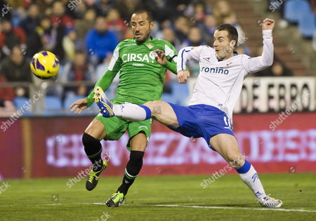 Real Betis' Defender Mario Alvarez (l) Fights For the Ball with Midfielder Paco Montanes of Real Zaragoza During Their Spanish First Division Soccer Match at La Romareda Stadium in Zaragoza 04 January 2013 Spain Zaragoza