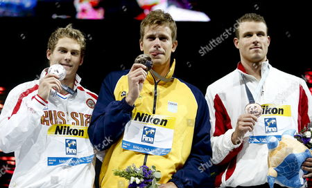 (l-r) Russian Vladimir Morozo Celebrates His Silver with Gold Winner Brazilian Cesar Cielo Filho and Us Bronze Medalist George Bovell During the Award Ceremony After the Men's 50m Freestyle Final at the 15th Fina Swimming World Championships at Palau Sant Jordi Arena in Barcelona Spain 03 August 2013 Spain Barcelona