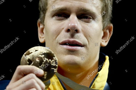 Cesar Cielo Filho of Brazil Celebrates During the Award Ceremony After Winning the Men's 50m Freestyle Final at the 15th Fina Swimming World Championships at Palau Sant Jordi Arena in Barcelona Spain 03 August 2013 Spain Barcelona