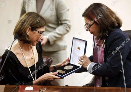 Spanish Journalist and Translator Pilar Del Rio (l) Widow of the Nobel Literature Prize Winner Portuguese Jose Saramago Receives the Award As Distinguished Visitor of Montevideo From the City Intendant Ana Olivera (r) For Continuing the Legacy of Jose Saramago in Montevideo Uruguay 21 August 2013 Uruguay Montevideo